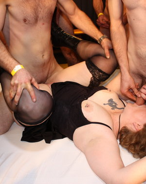 Naughty German BBW getting fucked in a gang bang