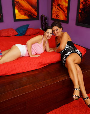 Old and young lesbian couple make out on the bed
