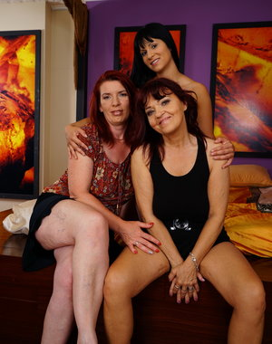 Three naughty old and young lesbians make out on the bed