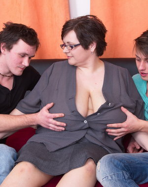 Two naughty toyboys doing a huge breasted mature lady