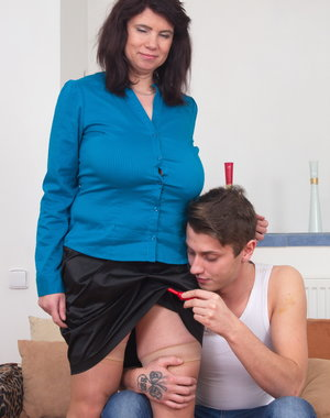 Chubby housewife playing with her toy boy