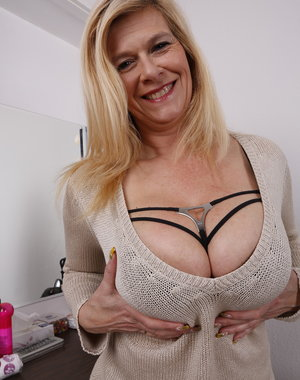 Big breasted German housewife showing her pierced pussy
