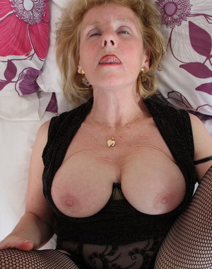 Pierced British mature lady getting ready to party alone