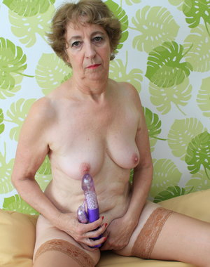 German mature lady having sex with a toy