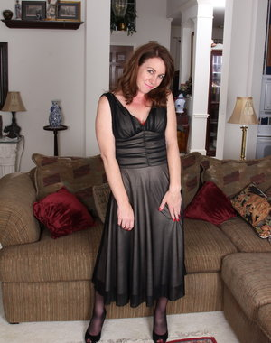 Cute American housewife playing naughty games