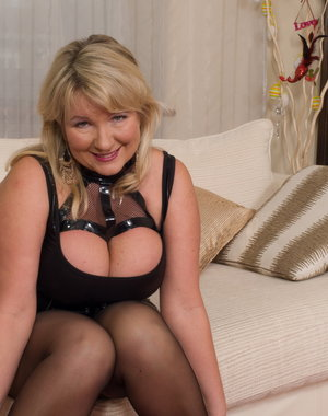 Big breasted British mature lady playing all alone