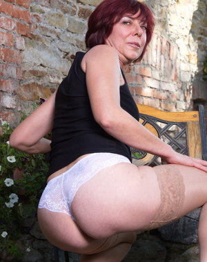 Naughty mature woman getting frisky in her garden