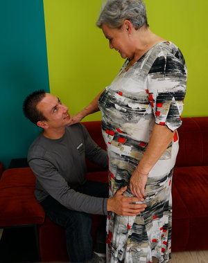 Older mature woman playing with her toy boy