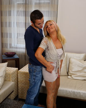 Naughty mature lady seducing a younger dude